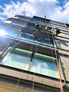high level glass replacement with abseilers