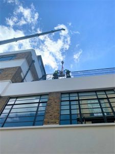 high level glass replacement with a crane