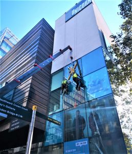 high level glass replacement using spider crane